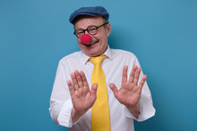 Man With Red Nose And Funny Ca...