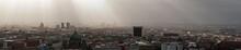 Panoramic Shot Of Town Against Sky