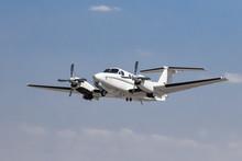 White Private Plane In The Sky