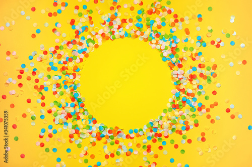 Yellow background with vivid confetti Canvas Print