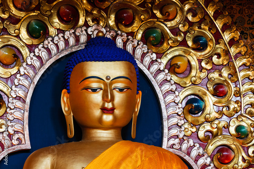 Fotografie, Obraz Gilded statue of Sakyamuni Buddha in Buddhist Tsuglagkhang temple gompa