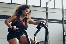 Young Woman Doing Air Bike Wor...