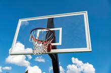 A Basket Ball Hoop On An Out Door Court