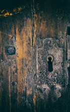 Detail Of Old Wooden Door And Keyhole