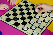 Children Play Checkers On A Co...