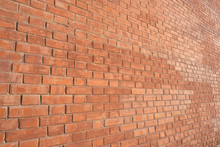 Brick Wall, An Angled View, Lit With Warm Light.