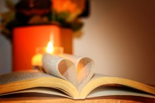Close-up Of Book Pages In Heart Shape