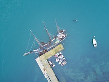 High Angle View Of Ship Sailing In Sea Against Sky