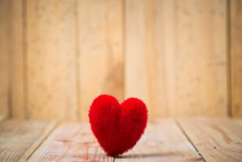 Close-up Of Red Heart Shape Decoration On Wooden Table