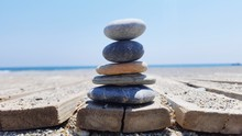Stack Of Pebbles On Beach Against Clear Sky