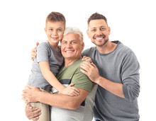 Man With His Father And Son On White Background