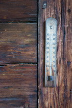 Close-up Of Weathered Thermometer On Wooden Wall