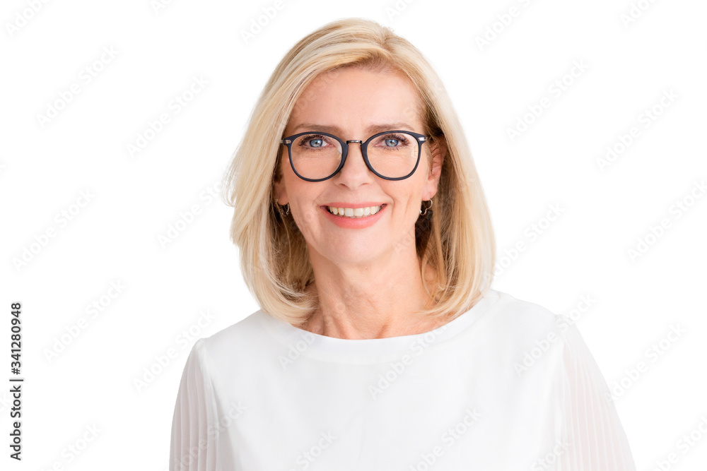 Fototapeta Attractive senior woman standing with arms crossed at isolated white background