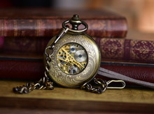 Close-up Of Antique Pocket Watch By Books On Table