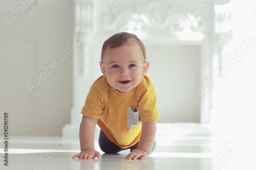 toddler child in a bright studio / little boy infant beautiful healthy child Wallpaper Mural