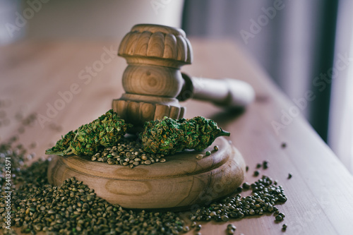 Legality of Medical Cannabis and  Seeds, legal and illegal Cannabis,  Seeds on the World - Wooden judge hammer and sound block with seeds and flower of marijuana CBD on the pinewood table background Canvas Print