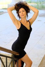 Girl In A Black Dress With An Open Neckline.