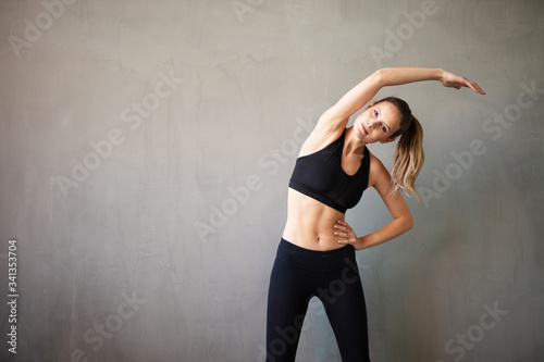 active person doing streaching on gray interior Canvas Print