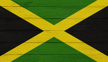 Jamaica Flag On A Wooden Textu...