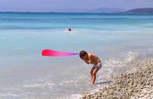 Photo Of A Boy On The Beach