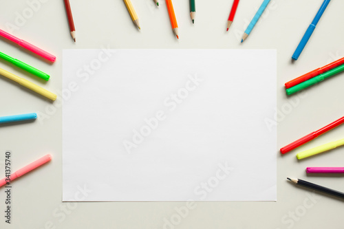 children desk with colorful pencils and white paper, top view school background Canvas Print