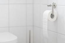 Toilet Roll In White Bath