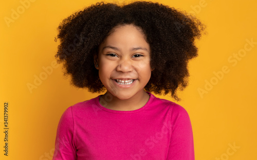 Obraz Portrait Of Funny Cute African American Little Girl Laughing At Camera - fototapety do salonu
