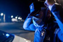 Portrait Of Policeman Wearing ...