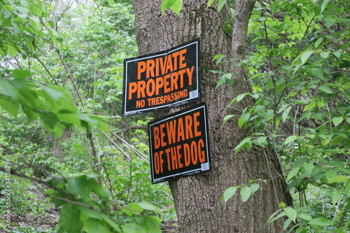 Private Property and Beware Of Dog Signs On Tree Canvas Print