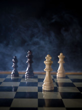Close-up Of Chess Pieces On Ta...