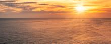 Sunset Over Horizon On Tropica...