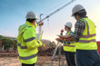 Civil engineer inspects work using radio communication with the management team in the construction area.