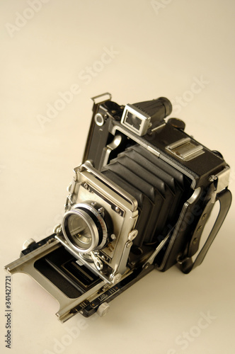 An old vintage 1940s bellows film camera with a sephia tone. Canvas Print