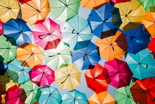 Low Angle View Of Colorful Umbrellas Hanging Outdoors