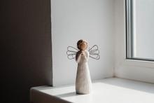 Wooden Angel Figurine Standing...