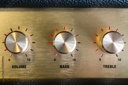 Photo knobs of guitar amplifier in gold