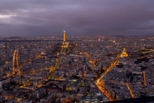 Eiffel Towers Amidst Cityscape Against Sky At Night