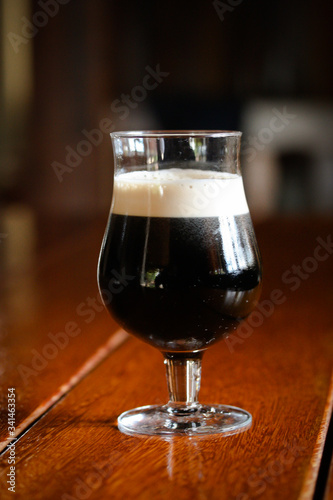 Glass of stout beer  on wooden table Canvas