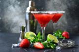 Cold summer strawberry cocktail with lime and mint ( mojito, margarita, rossini,daiquiri ) in a martini glasses.