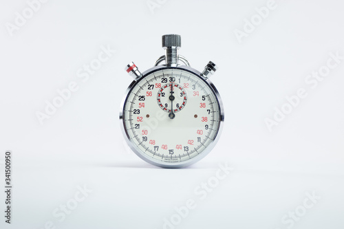 Photo Analogic vintage chronometer clock with red and black numbers on white backgroun