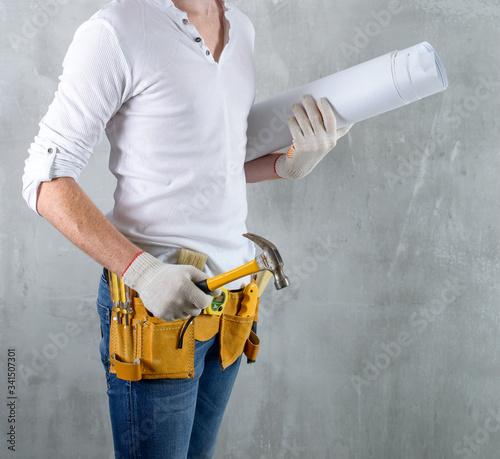brutal builder architect on a concrete background Tablou Canvas