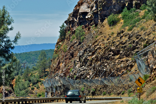Fototapeta Rockfall barrier fence  to mitigate small boulders from hitting cars, highway 29
