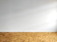 Empty White Office Wall With Hardwood Floor