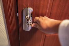 Close-up Of Hand Holding Door ...