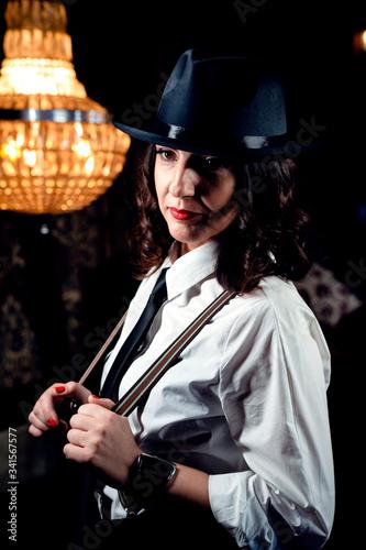 Mafia game in restaurant. Beautiful woman in gangster image Fototapet