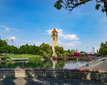 The Spokane River With The Clock Tower, Bridge And Downtown Visible In Riverfront Park, Spokane Washington.
