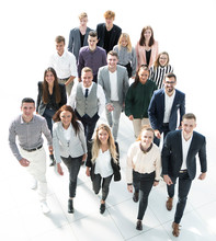 Group Of Diverse Young Business People Walking Together