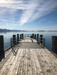 Wooden Jetty Leading To Pier Over Sea Against Sky