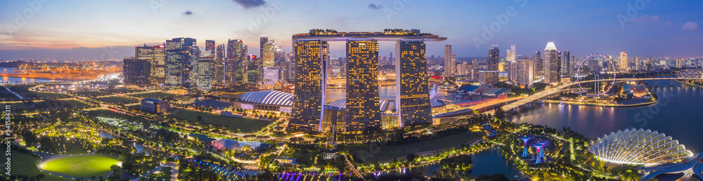 Fototapeta Aerial drone view of Singapore business district and city, Business and financial district Modern building in the city center of Singapore on February 2, 2020 in Singapore.