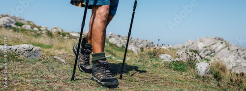 Fototapeta Unrecognizable senior man practicing trekking outdoors obraz